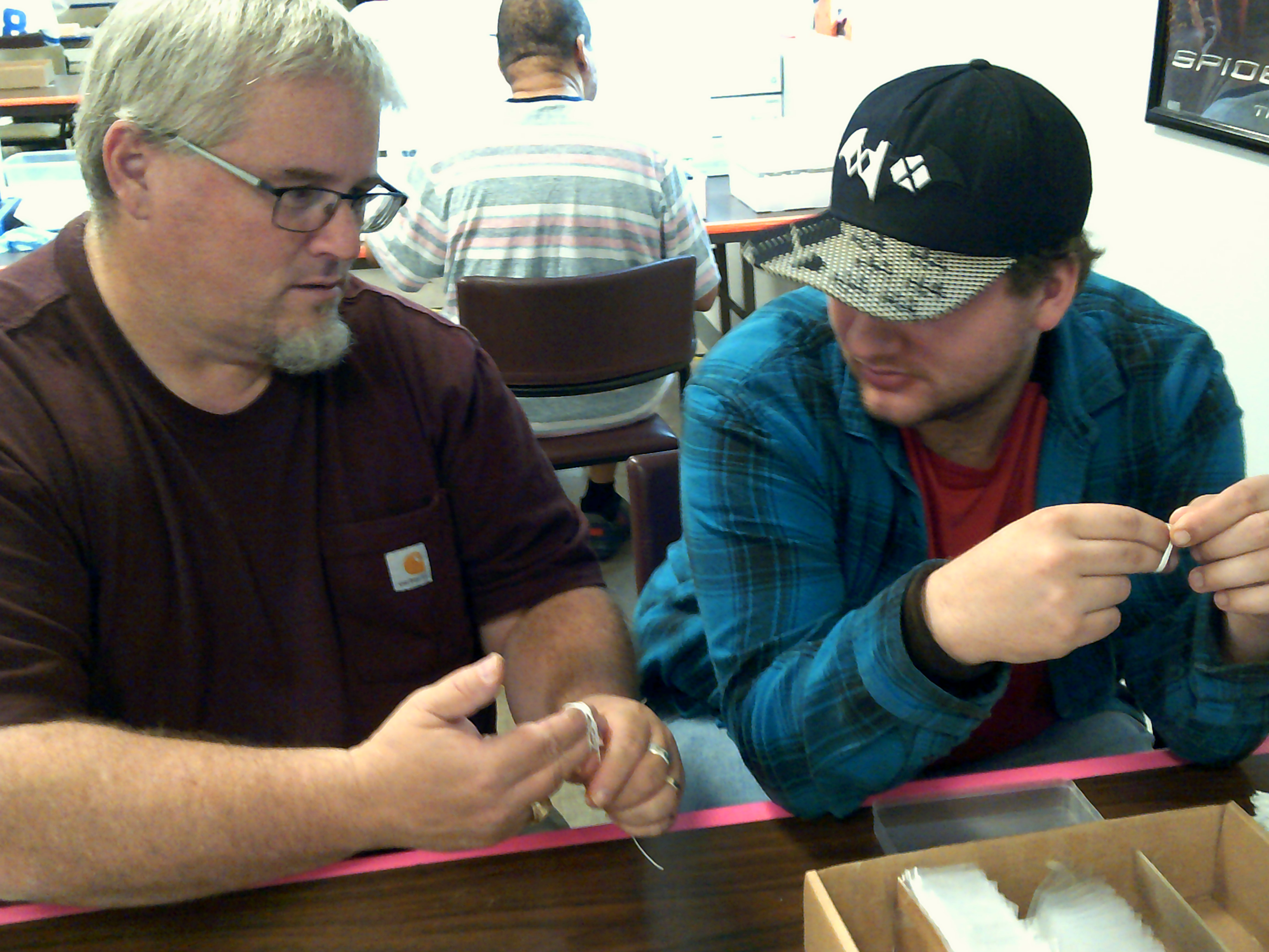 Mike Jewell works with a participant at the Vocational Training Center.
